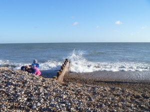 Waves and family by groyne
